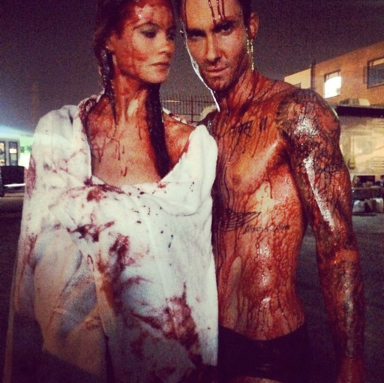 "Adam Levine and Behati Prinsloo Get All Naked and Bloody for ""Animals"" Video"