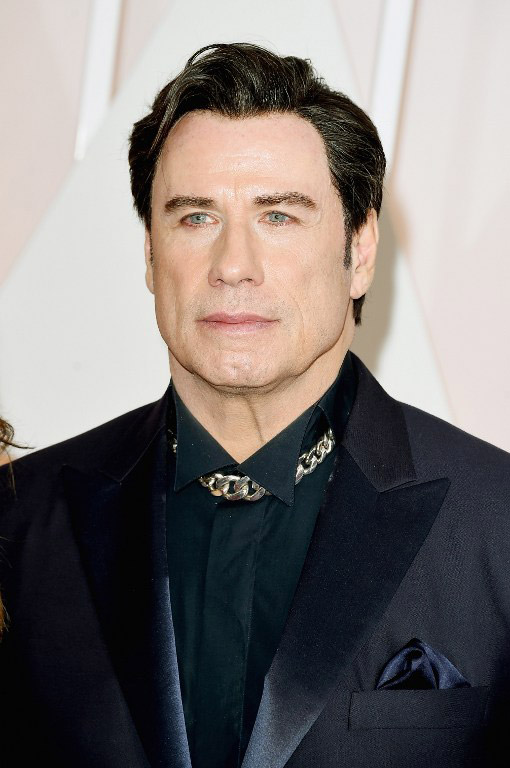 John Travolta Wears a Choker and Guyliner to the Oscars