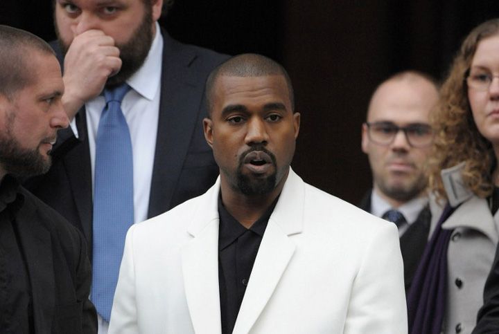Kanye and Beckham Mourn at London Fashion Week