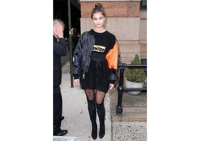 Model Taylor Hill in black suede HIGHLAND boots while spotted out in New York City.