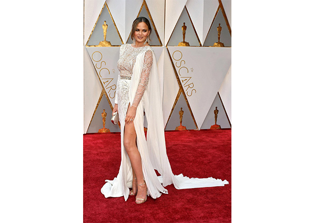 Chrissy Teigen in chino washed nappa NUDIST sandals at the 89th Annual Academy Awards.