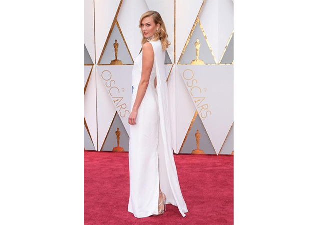 Karlie Kloss in tin glass GOFORTH sandals at the 89th Annual Academy Awards.