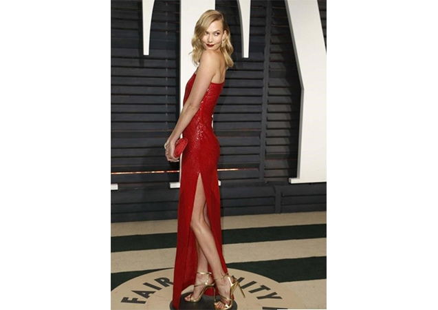 Karlie Kloss in pale gold glass GOFORTH sandals at the 2017 Vanity Fair Oscars Party.