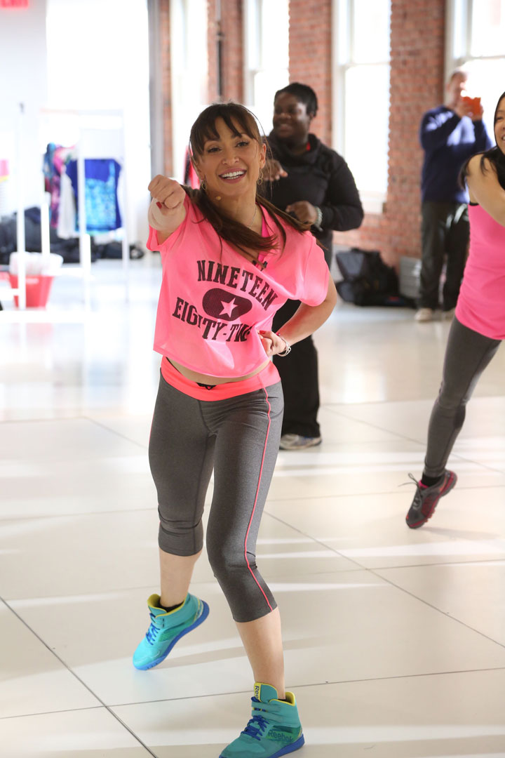 Karina Smirnoff wearing CityStreet and Xersion Activewear while teaching a danceclass at JCPenney's New Year, New You Fitness Event